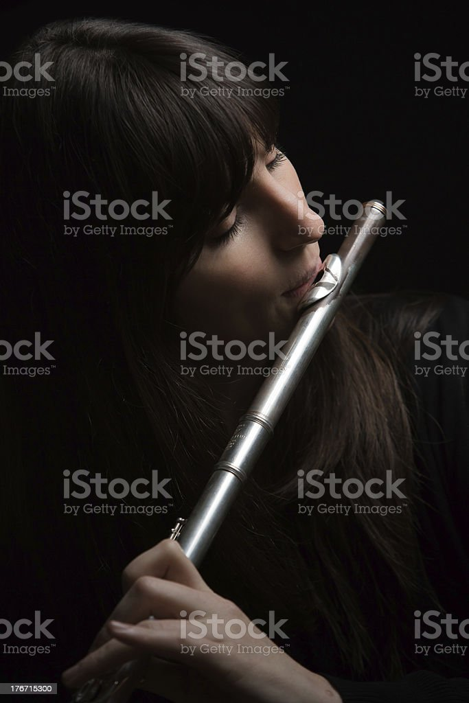 Flute player reciting with emotion royalty-free stock photo