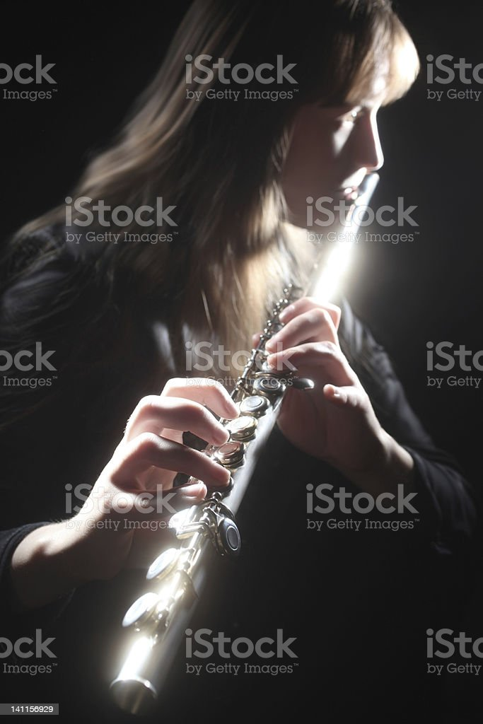 Flute playing flutist classical musician stock photo