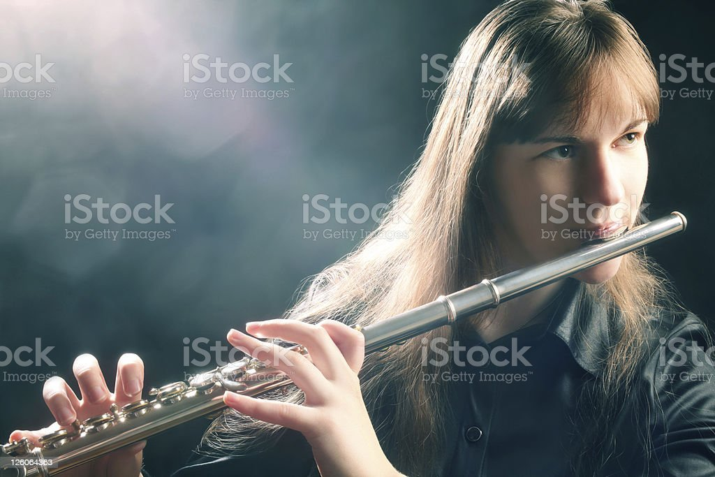 Flute playing flutist musician performer stock photo