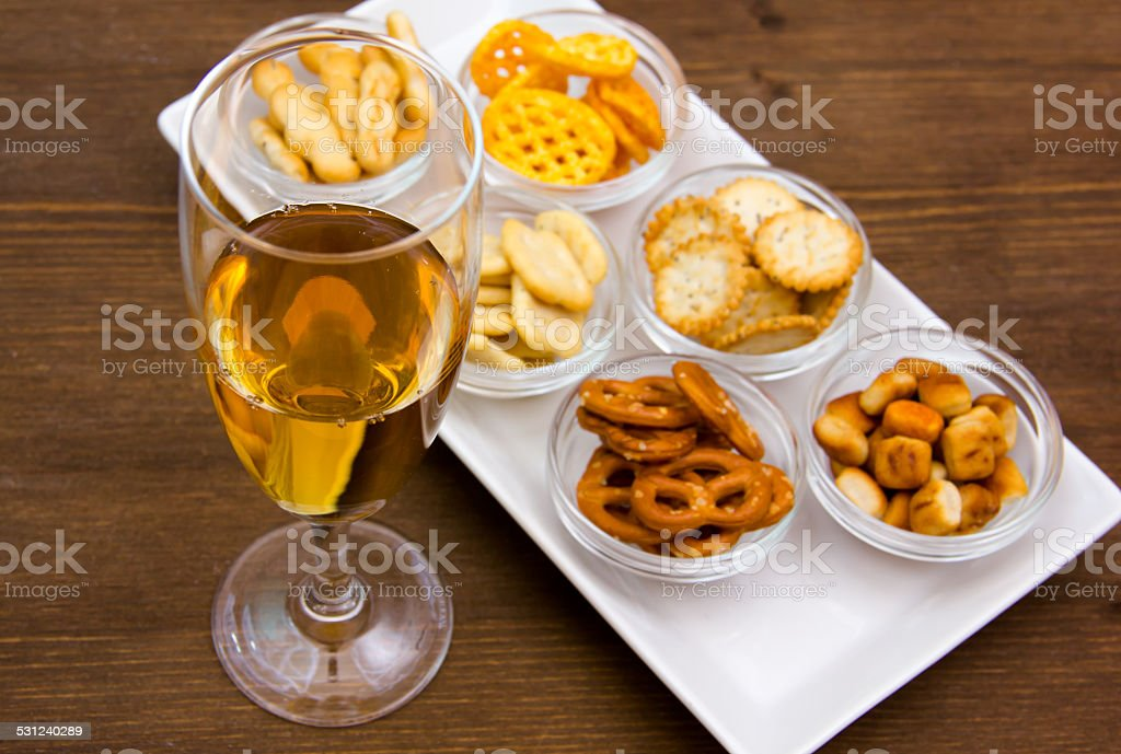Flute with aperitif and pretzels stock photo