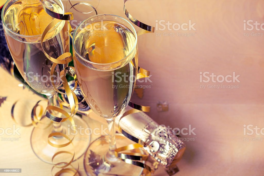Flutes of champagne in holiday setting stock photo