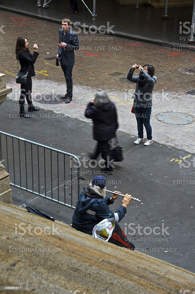 Flutist at Federal Hall steps, Wall Street, New York City royalty-free stock photo