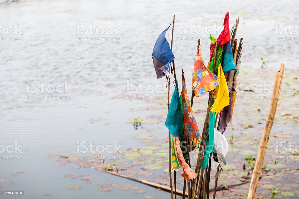 Fluttering Flag at the Lake stock photo
