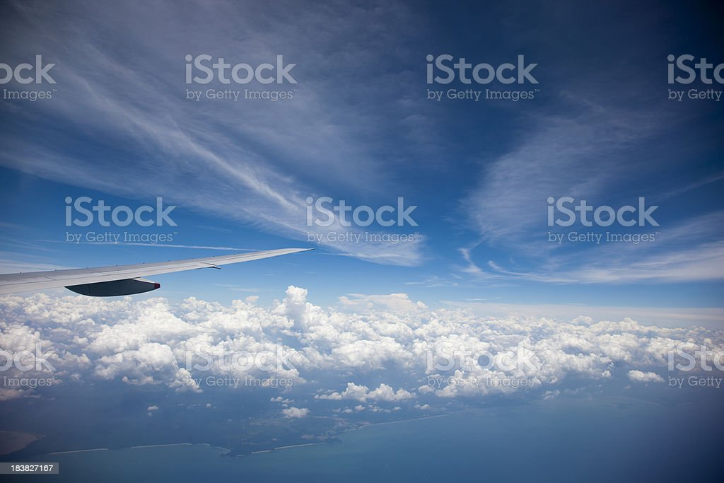 fly above cloud stock photo