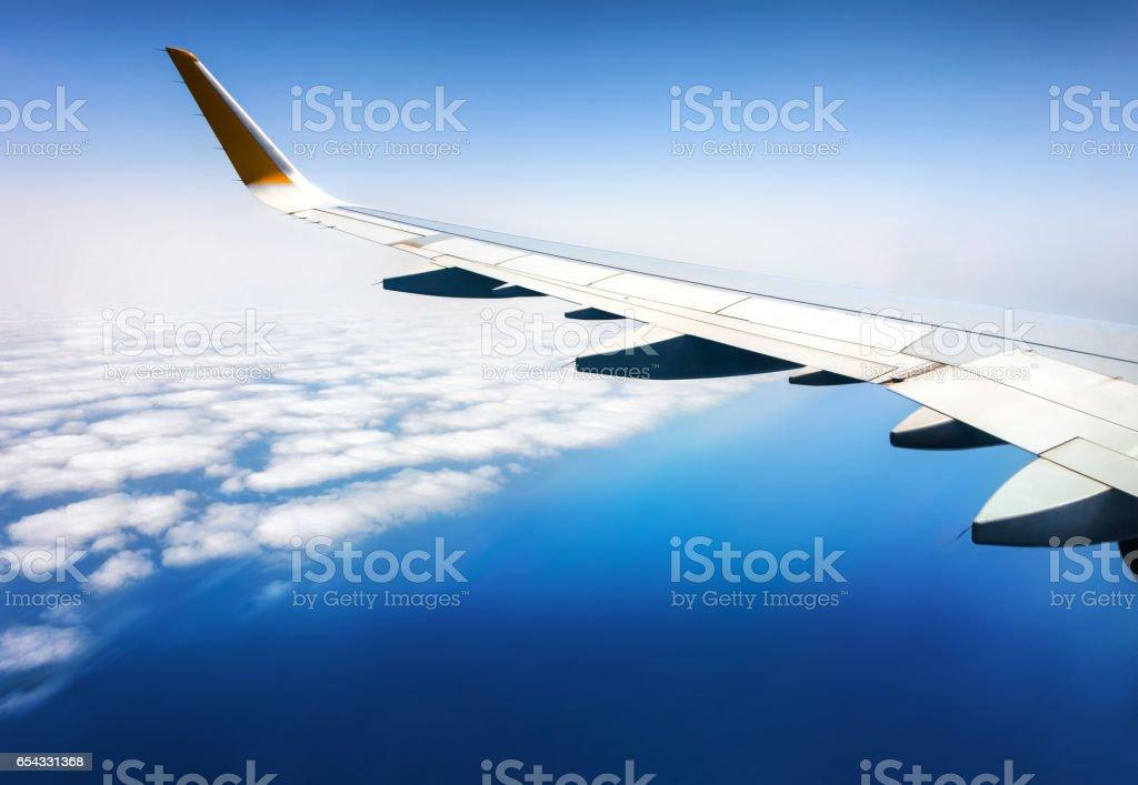fly airplane avion window wing sea stock photo