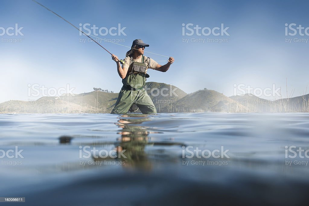 Fly Fisherman Casting stock photo