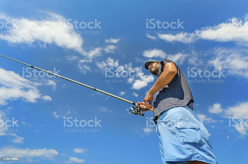 Fly Fisherman Casting. royalty-free stock photo