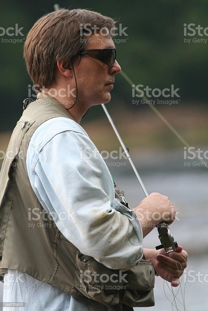 fly fisherman closeup royalty-free stock photo