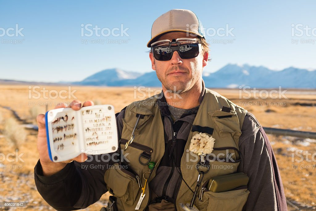 Fly fisherman Showing His Fly Box stock photo