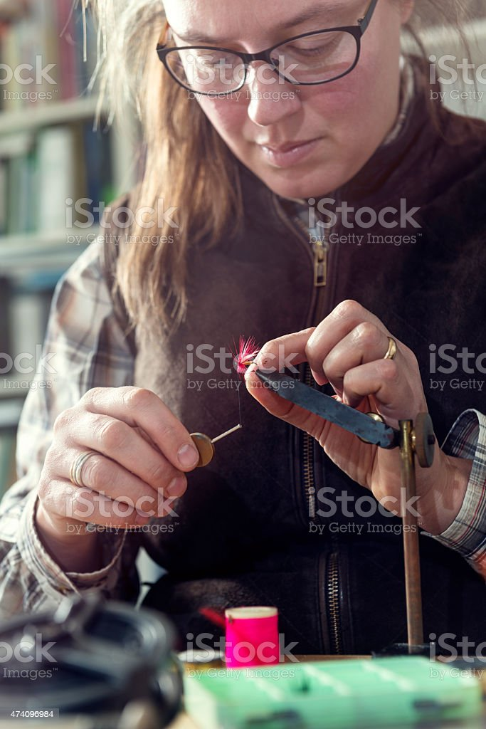 Fly Fisherman Tying Flies For Ready For Fishing stock photo