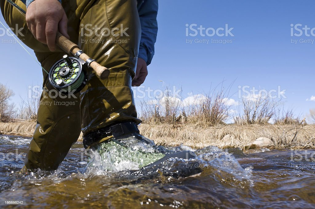 Fly Fisherman Wading Through River Water Cropped Detail stock photo