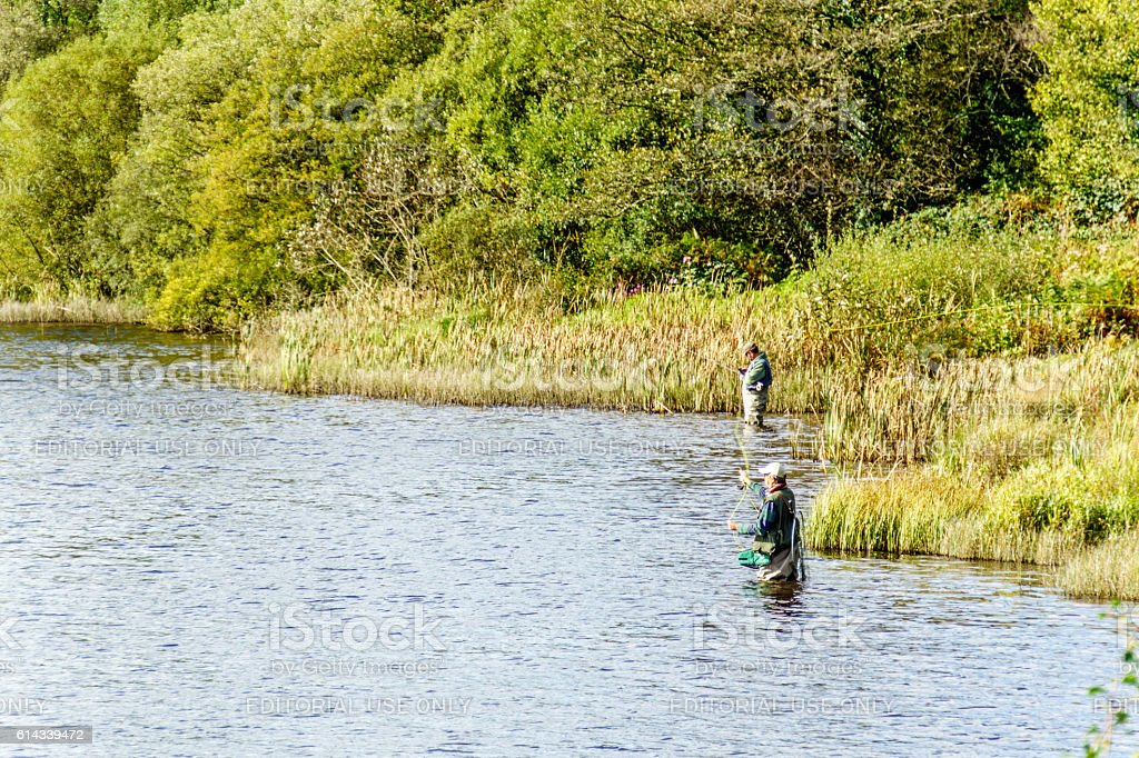 Fly fishermen solitude at the lake stock photo