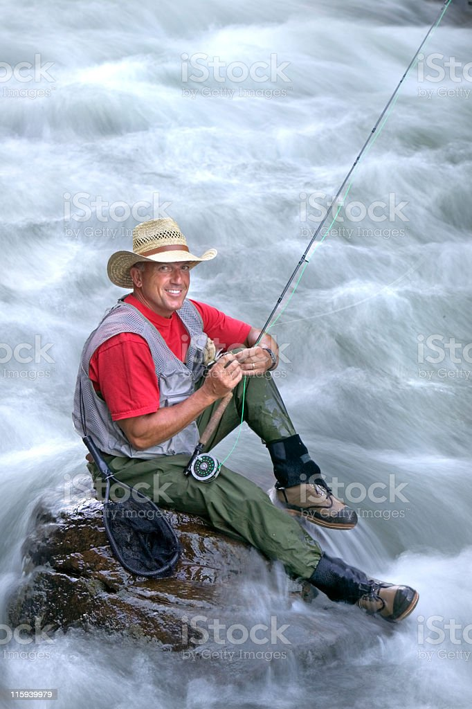 Fly Fishing against Flowing Stream royalty-free stock photo