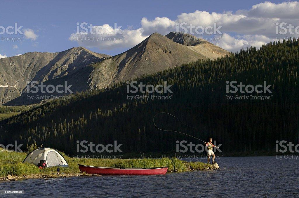 Fly Fishing at Lake Side Mountain Camp royalty-free stock photo