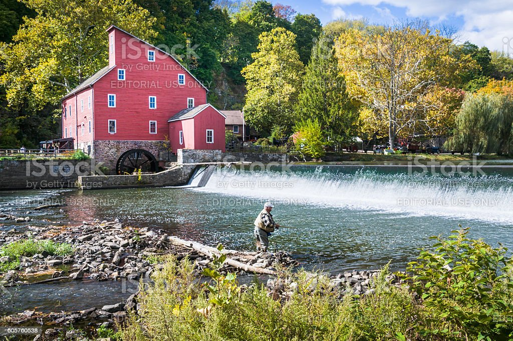 Fly Fishing at the Old Mill stock photo