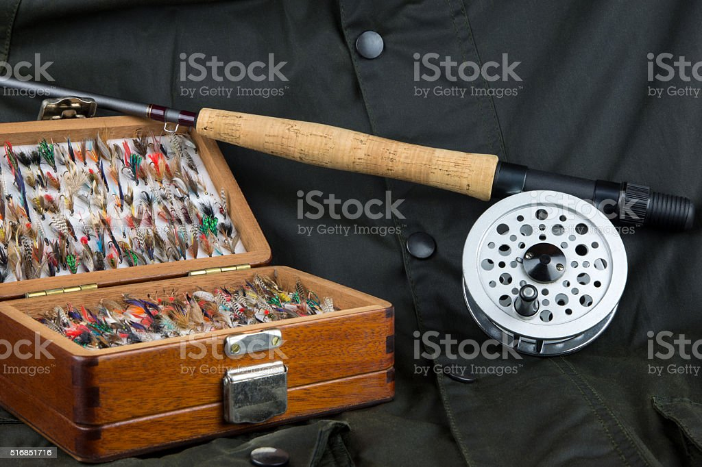 Fly Fishing Equipment and Outdoor Coat stock photo