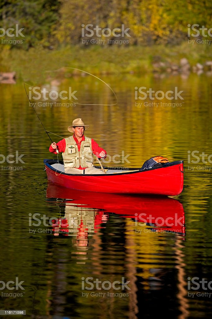 Fly Fishing From a Canoe in Colorado stock photo