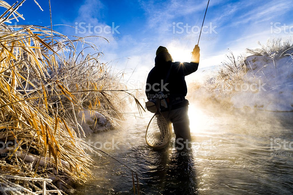 Fly Fishing in Extreme Cold Winter Conditions stock photo