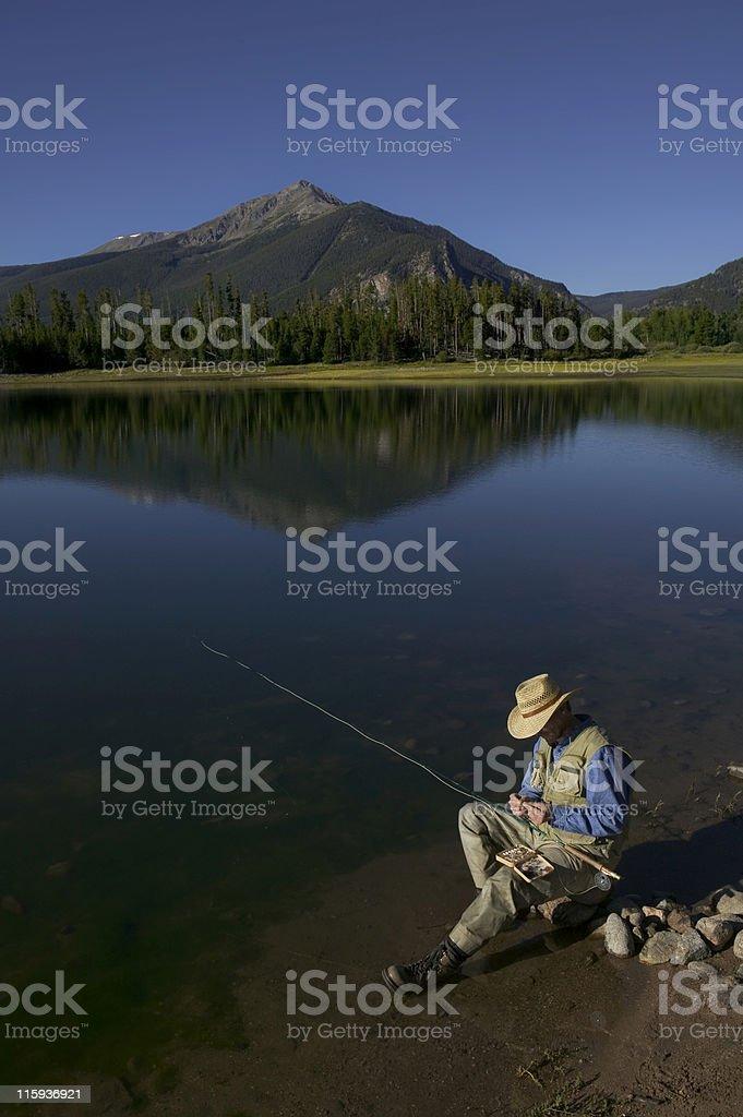 Fly Fishing in Mountain Lake royalty-free stock photo