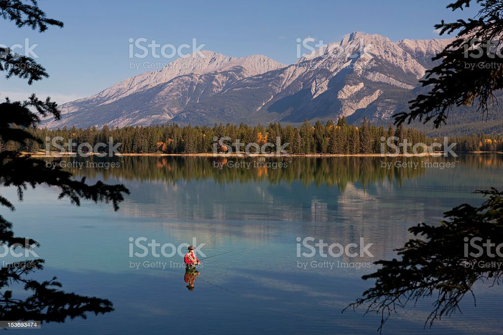 Fly Fishing In Rocky Mountains, Alberta, Canada royalty-free stock photo
