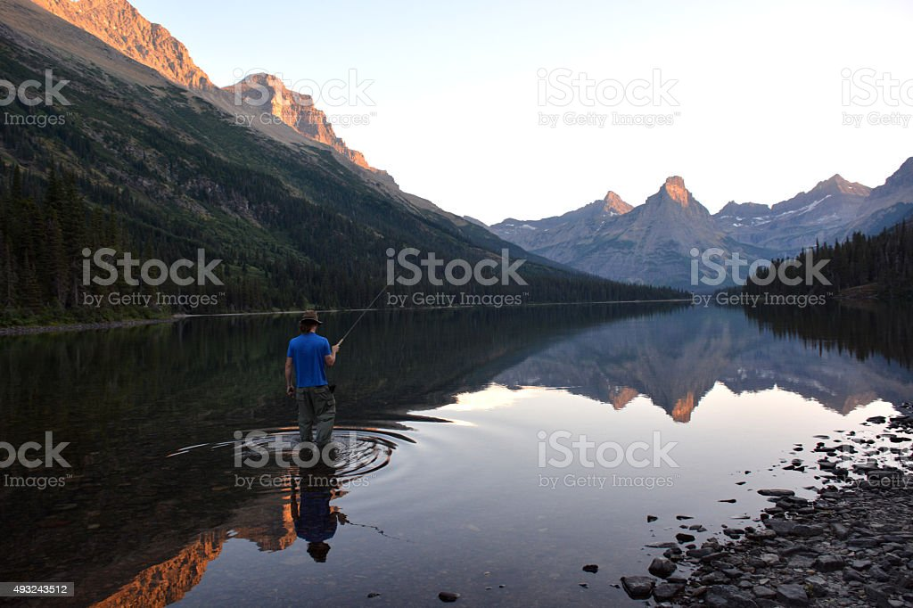 Fly fishing in the Mountains stock photo