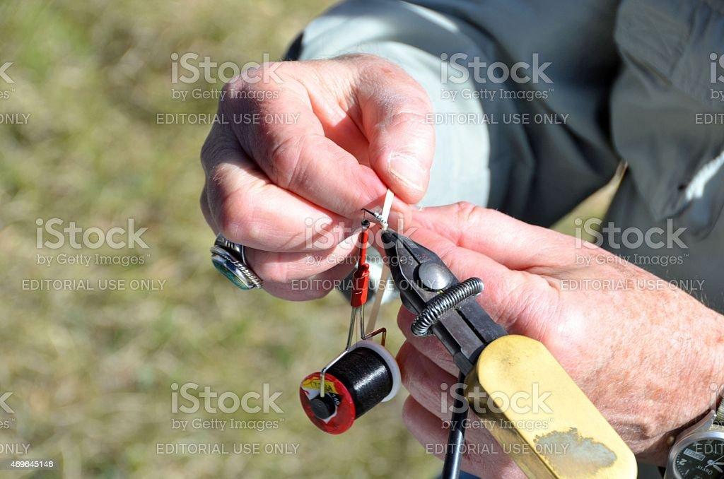 Fly Fishing Knot Tying stock photo
