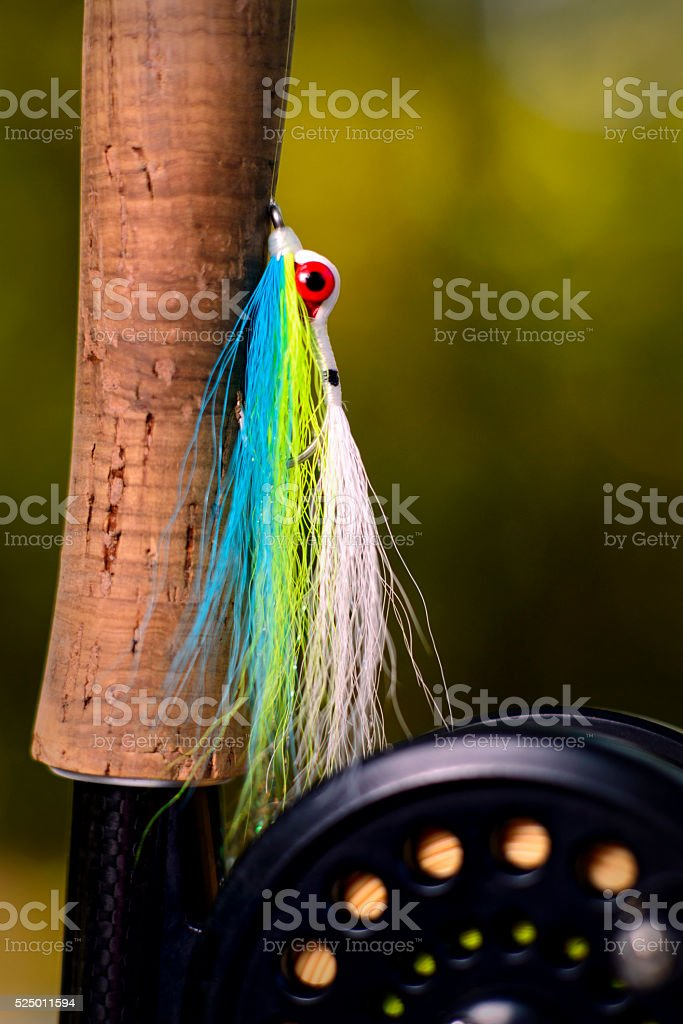 Fly Fishing Lure and Reel stock photo