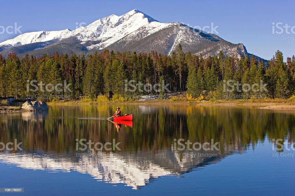 Fly Fishing On A Colorado Lake. stock photo