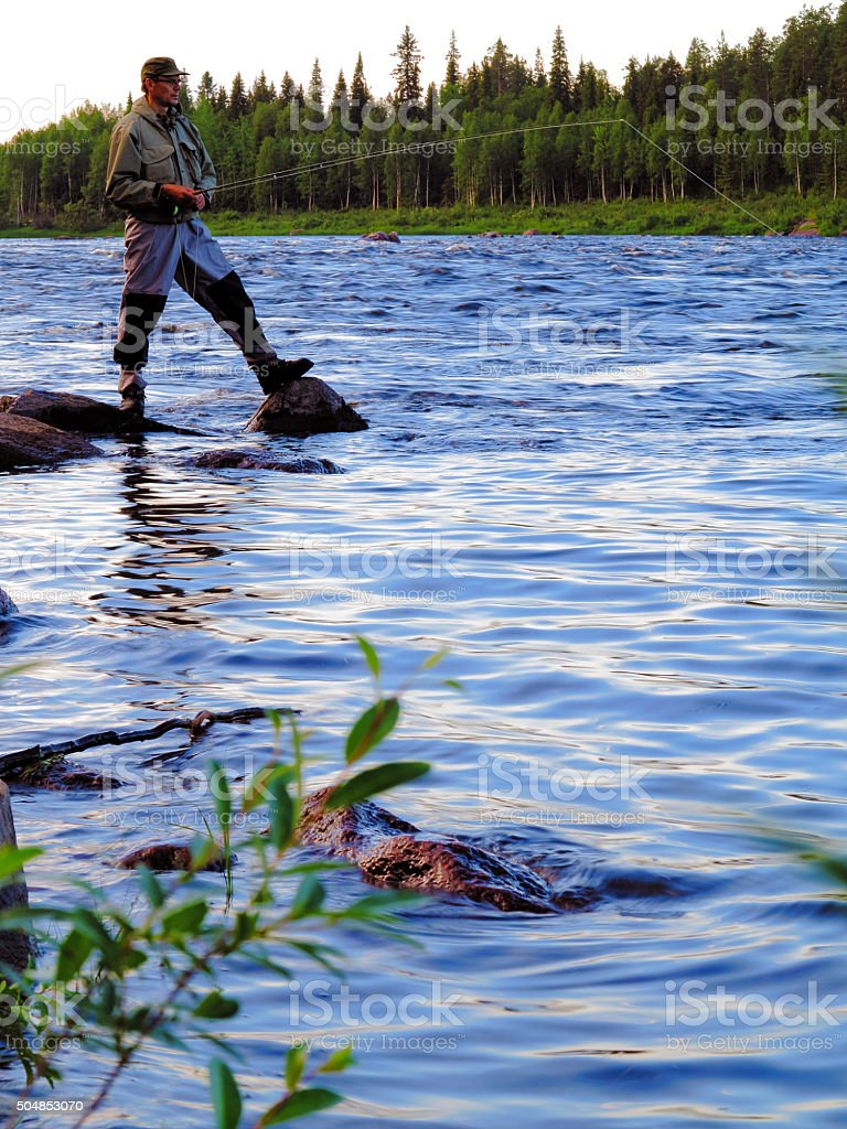 Fly fishing on a river stock photo