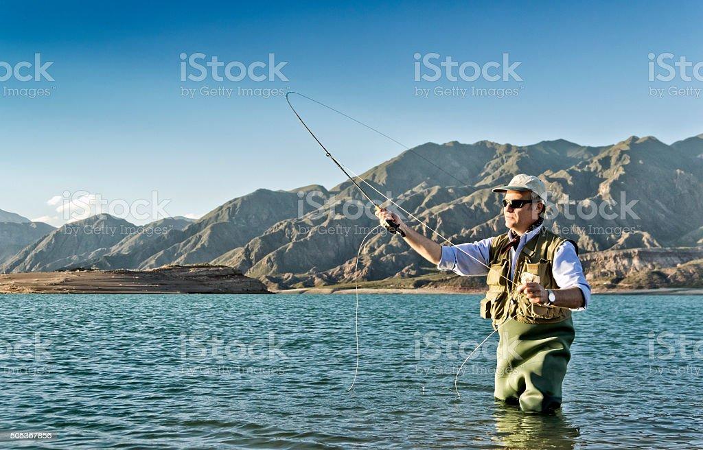 Fly fishing on lake stock photo