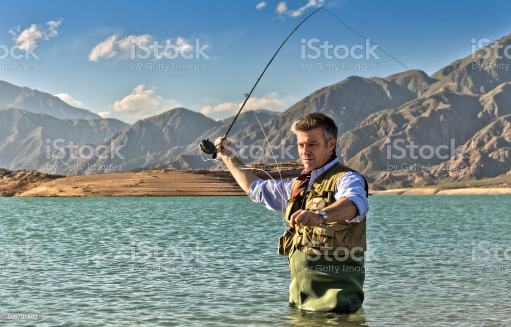 Fly fishing on lake stock photo