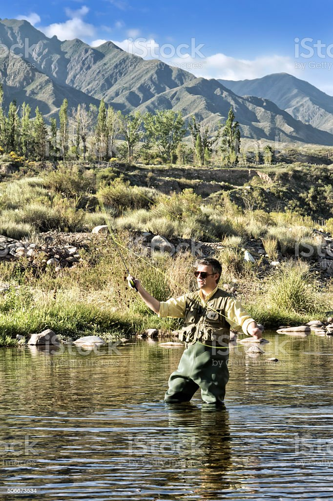 Fly fishing on the river stock photo