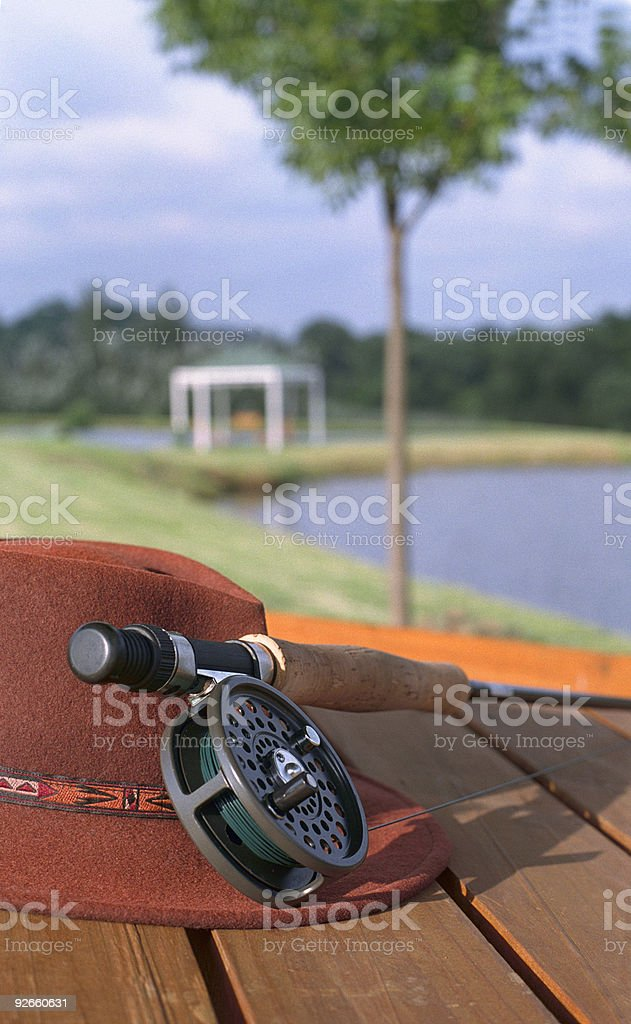 Fly fishing reel and hat. stock photo