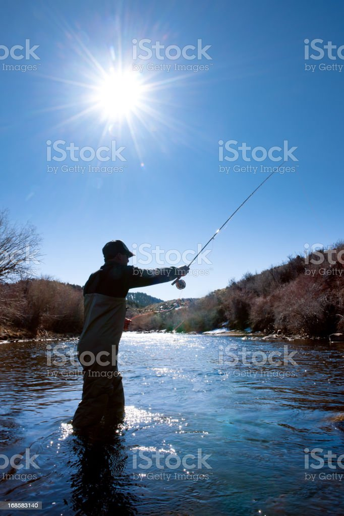 Fly Fishing Silhouette royalty-free stock photo