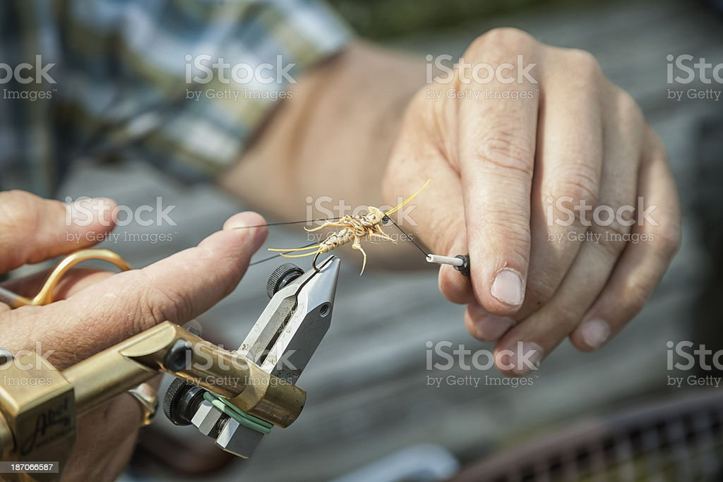 Fly Fishing: Tying a Lure royalty-free stock photo
