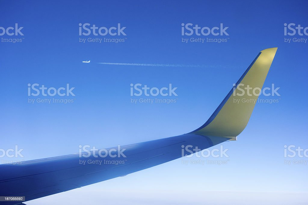 Fly over atlantic wing and blue sky stock photo
