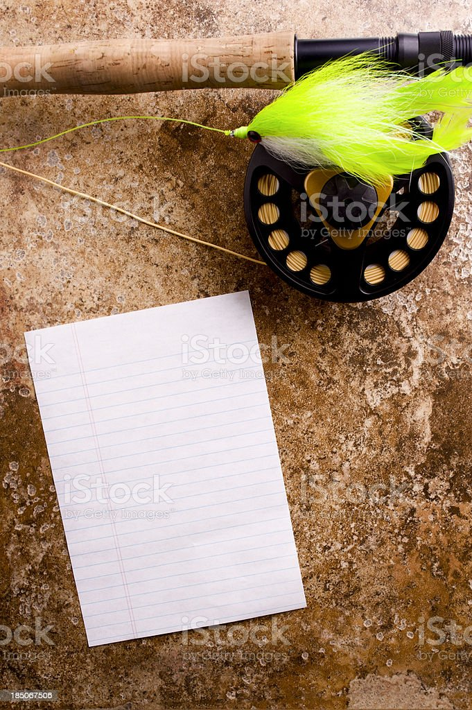Fly Rod and Paper stock photo