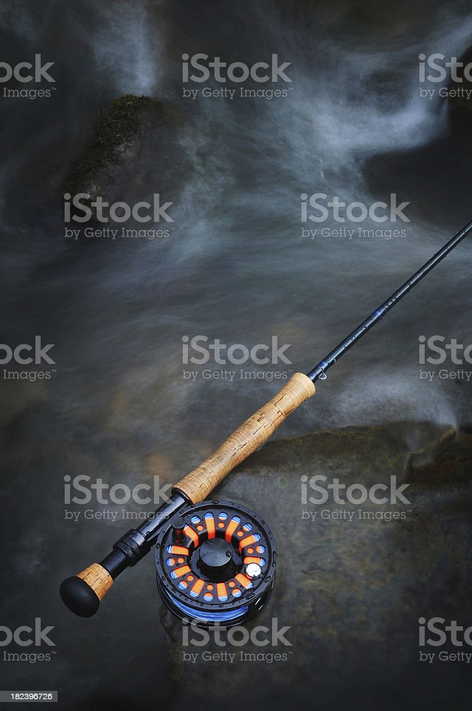 Fly rod in moving water stock photo