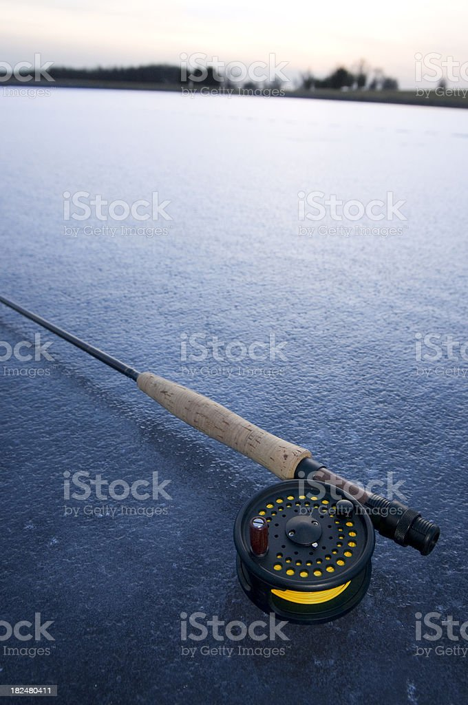 Fly rod on blue ice stock photo