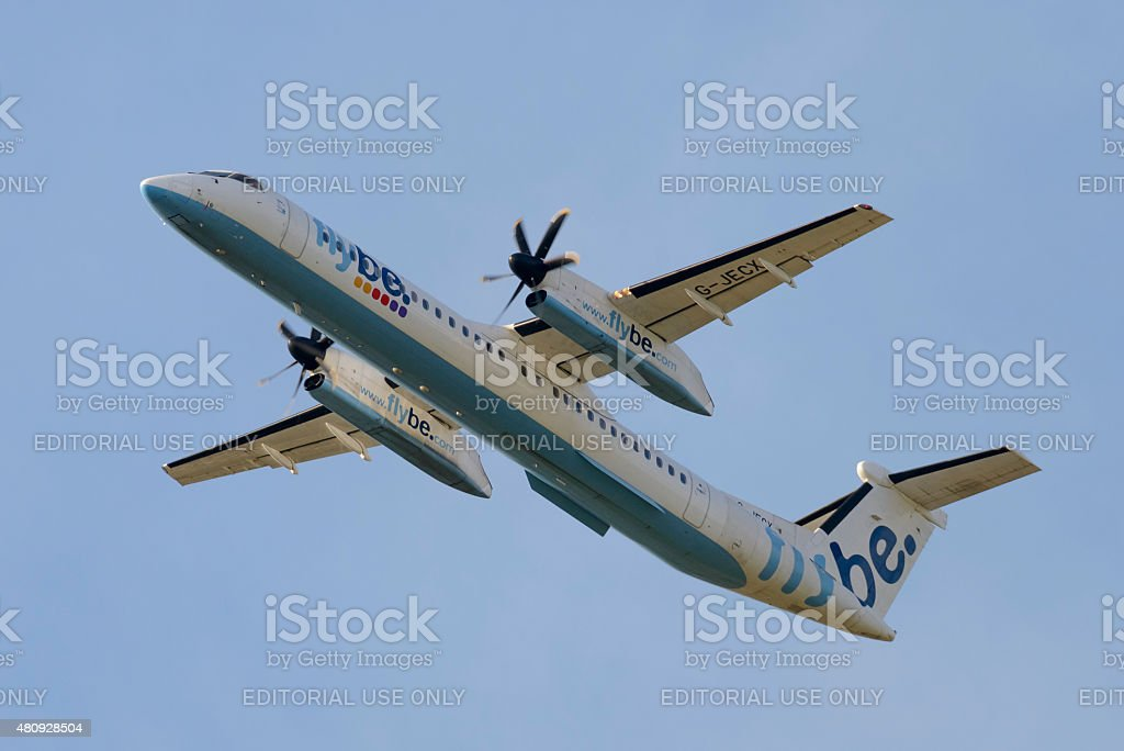 Flybe Bombardier Dash 8 or Q-Series airplane flying stock photo