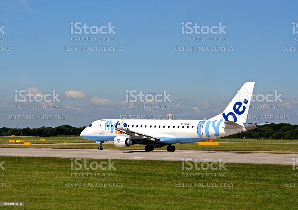 Flybe Embraer ERJ-175STD taxiing at Manchester Airport. stock photo
