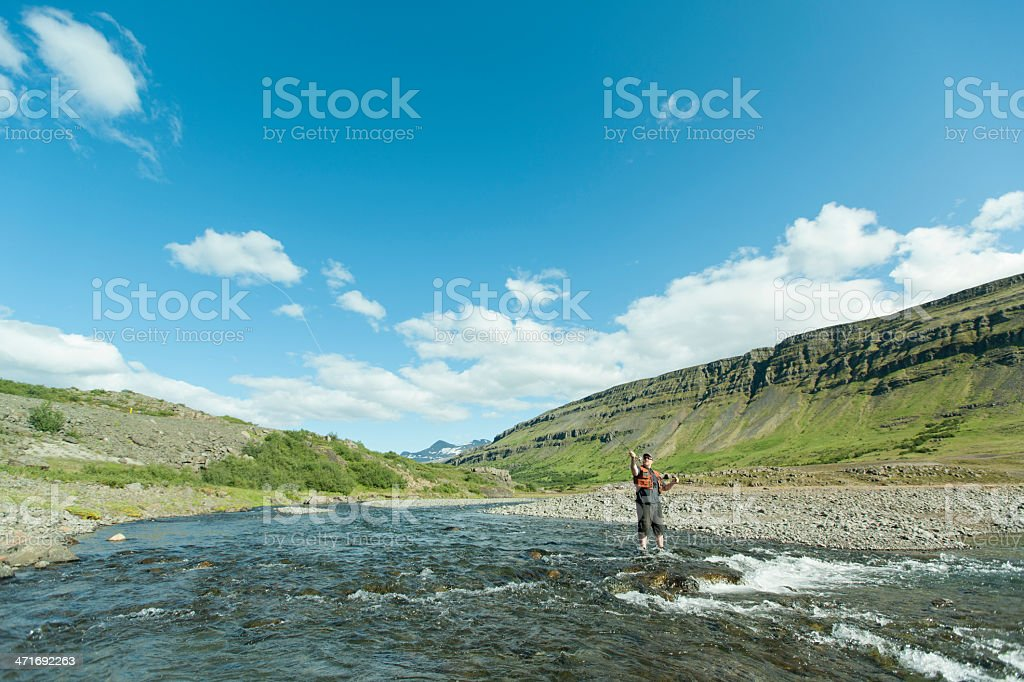 Flyfisherman casting royalty-free stock photo