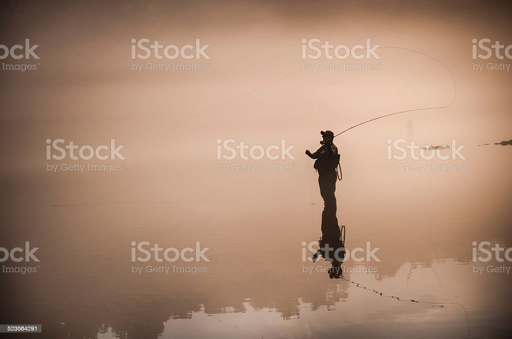 Flyfisherman Silhouette stock photo
