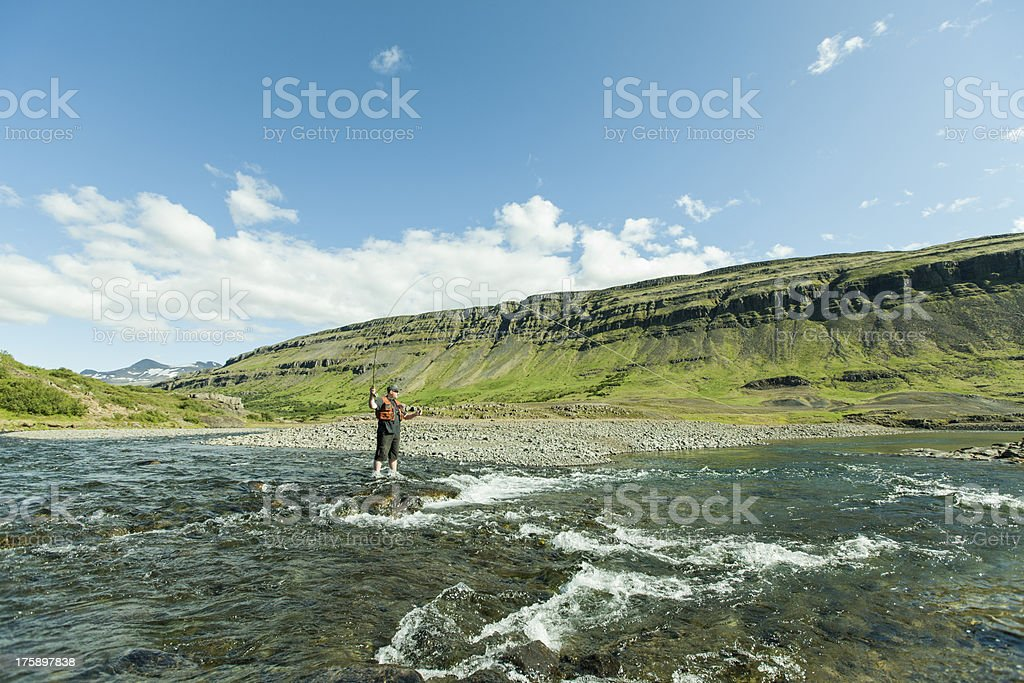 Flyfisherman with a catch royalty-free stock photo