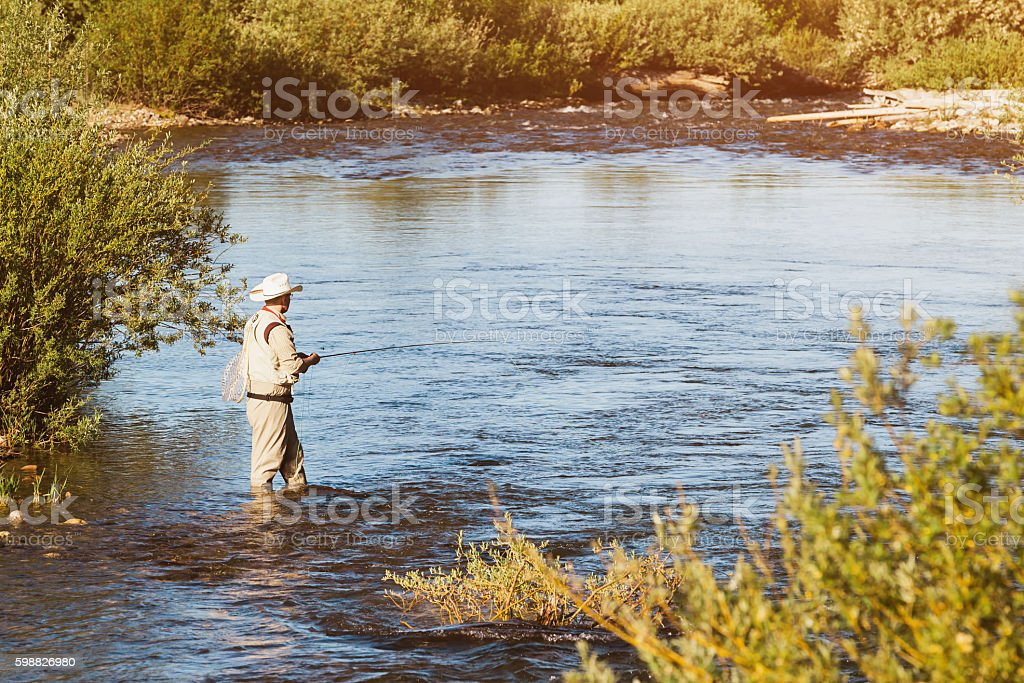Fly-Fishing at Sunset in Montana River USA stock photo