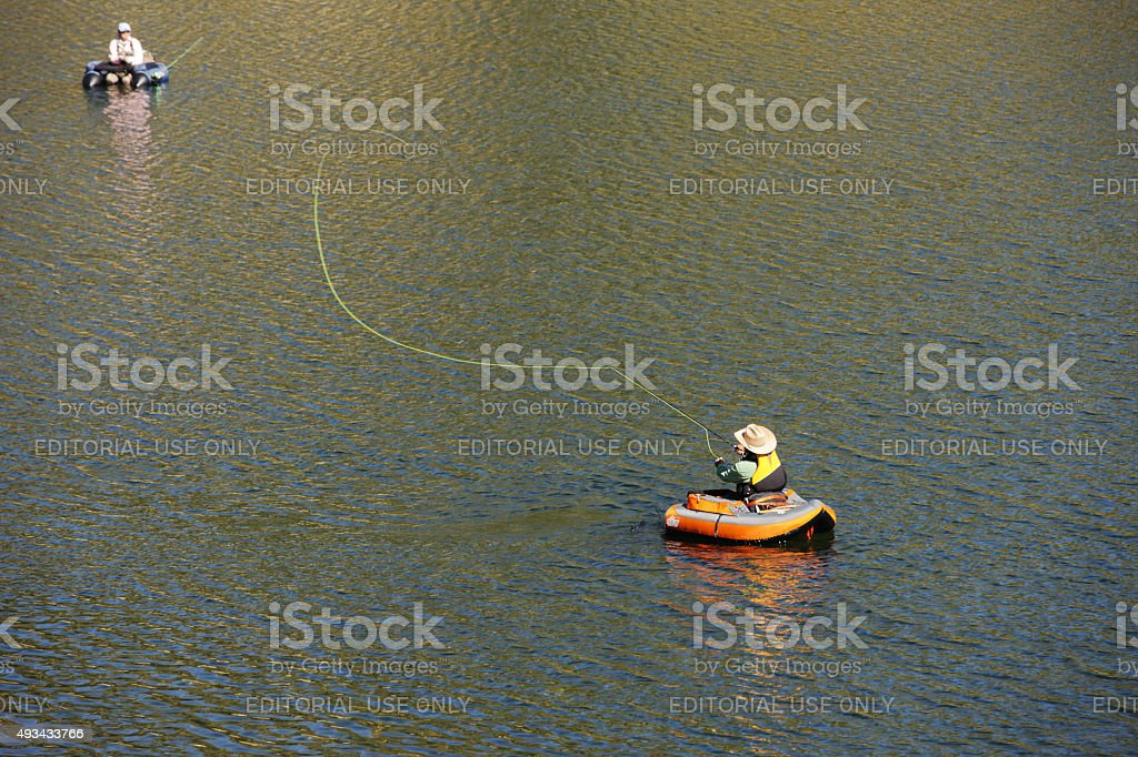 Fly-Fishing Trout Fishermen Boat Casting stock photo