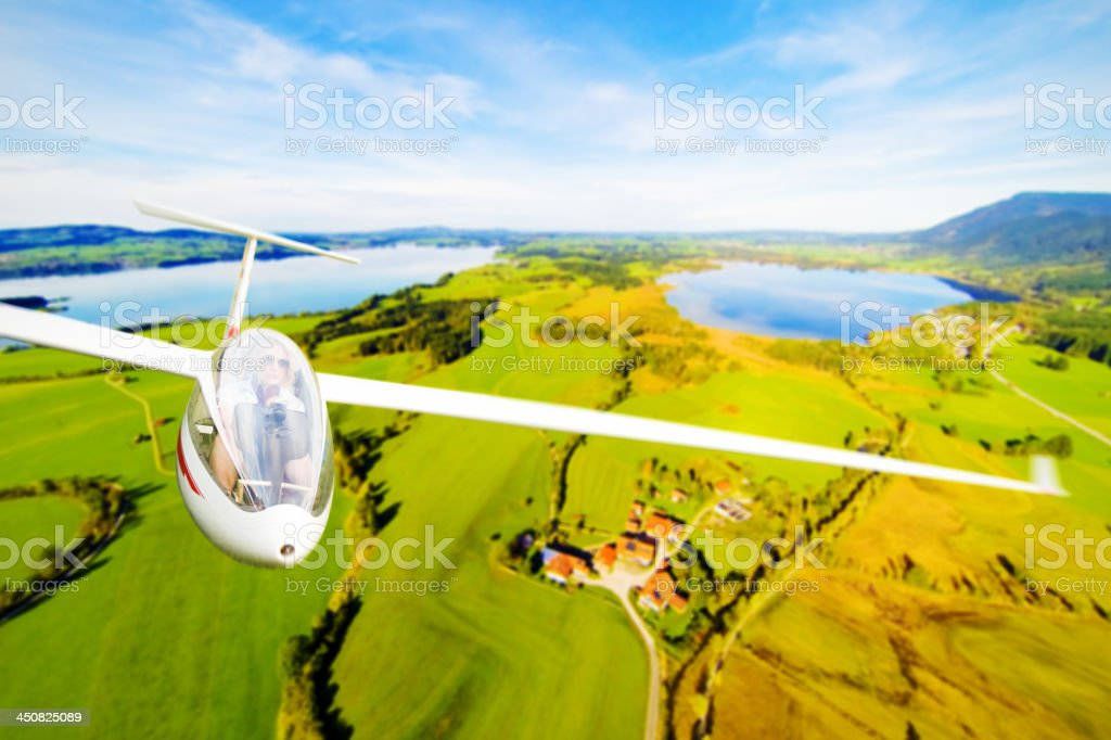 flying a glider plane stock photo