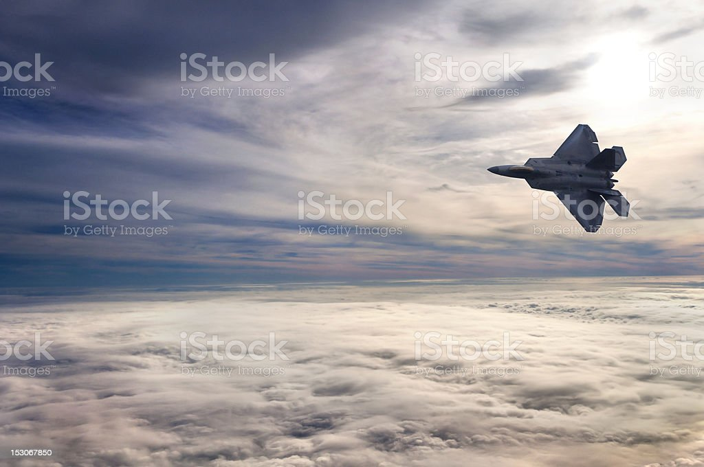 F22 Flying Above the Clouds stock photo