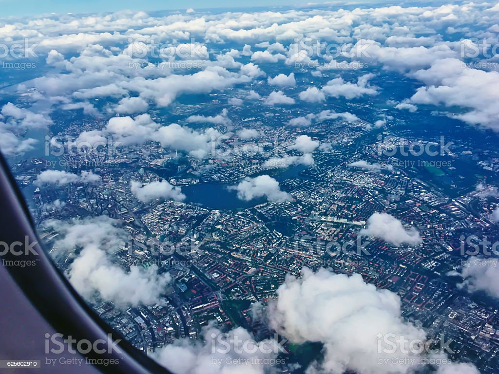 Flying above white cumulus clouds stock photo