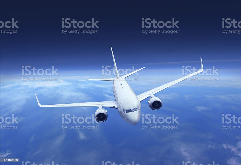 Flying Airplane above the Earth royalty-free stock photo